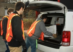 SCI AmeriCorps Members Loading Recyclables.